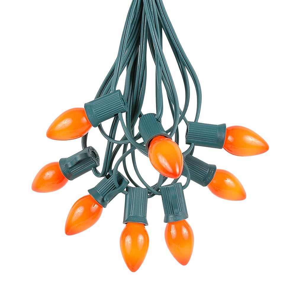 Picture of 100 C7 String Light Set with Orange Ceramic Bulbs on Green Wire