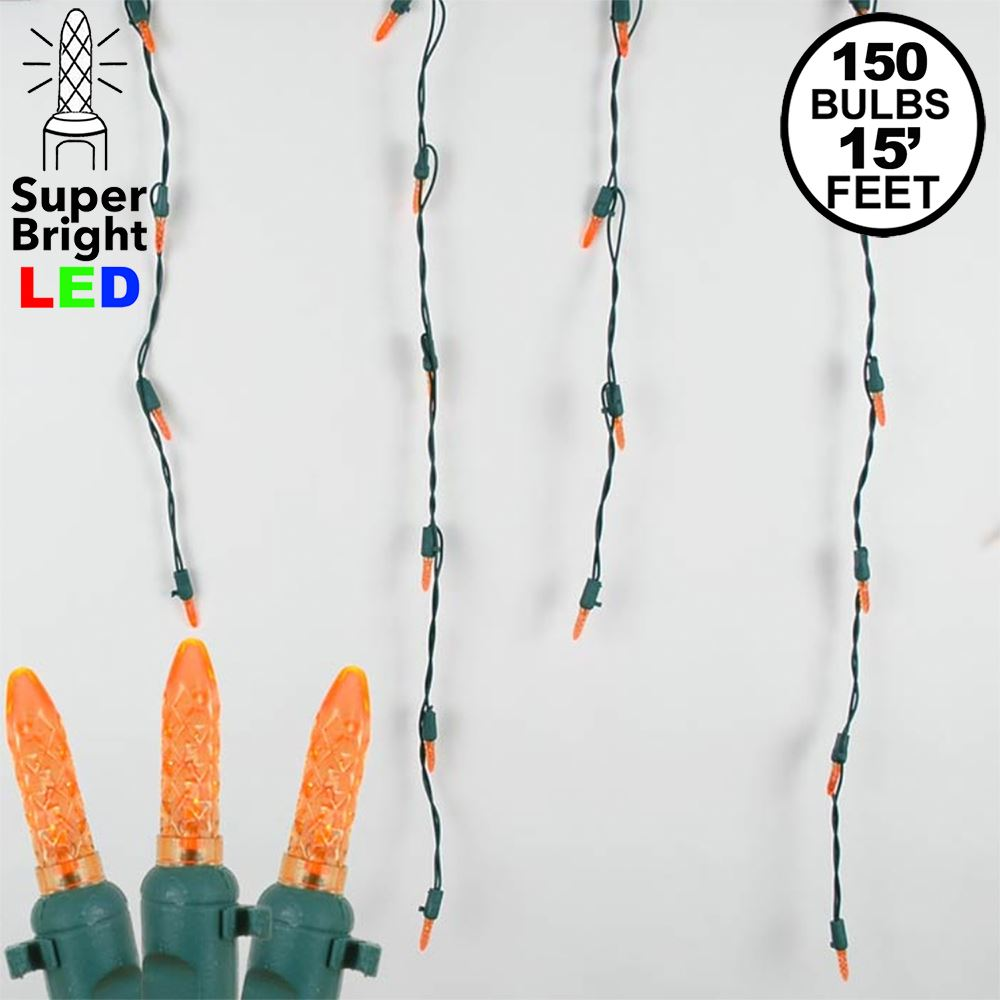 Picture of Orange (amber) LED Icicle Lights on Green Wire 150 Bulbs